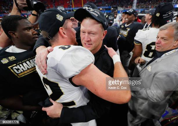 Head coach Scott Frost of the UCF Knights celebrates after defeating the Auburn Tigers 3427 to win the ChickfilA Peach Bowl at MercedesBenz Stadium...
