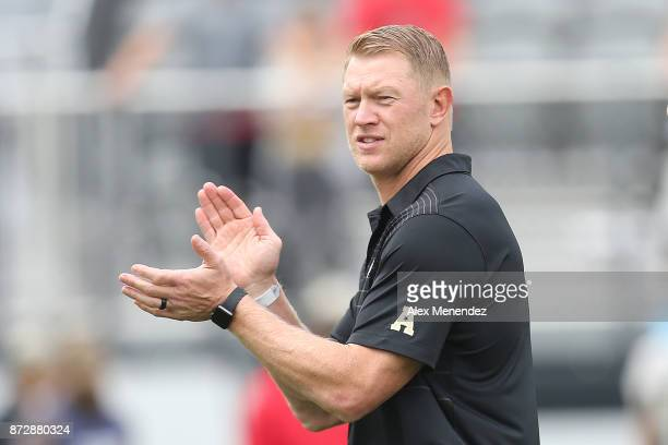 Head coach Scott Frost of the UCF Knights is seen during a NCAA football game between the University of Connecticut Huskies and the UCF Knights on...