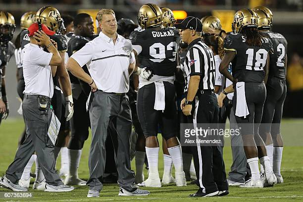 Head coach Scott Frost of the UCF Knights looks at Head Linesman Steven Matarante during a NCAA football game between the Maryland Terrapins and the...