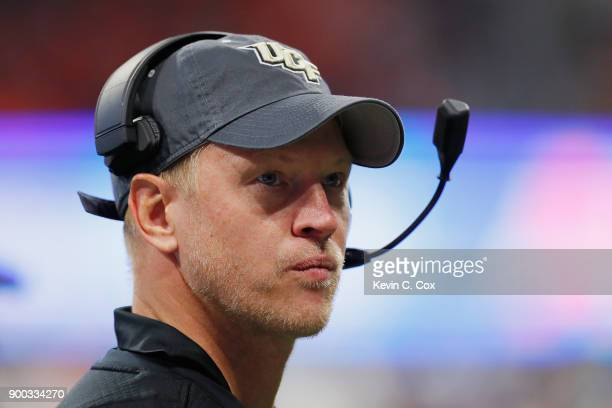 Head coach Scott Frost of the UCF Knights looks on in the second half against the Auburn Tigers during the ChickfilA Peach Bowl at MercedesBenz...