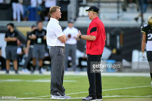 Head coach Scott Frost of the UCF Knights talks with head coach D J Durkin of the Maryland Terrapins before the game at Bright House Networks Stadium...