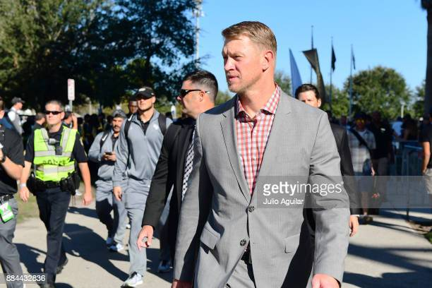 Head coach Scott Frost of the UCF Knights walks up to the stadium with his team before pregame of the 2017 AAC Championship against the Memphis...