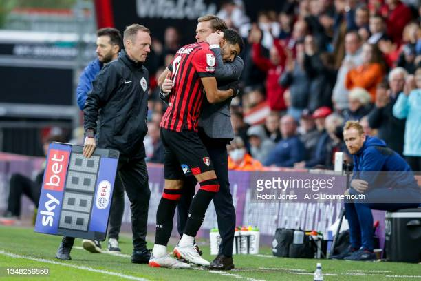Head Coach Scott Parker hugs Dominic Solanke of Bournemouth as he is subbed off after scoring two goals during the Sky Bet Championship match between...