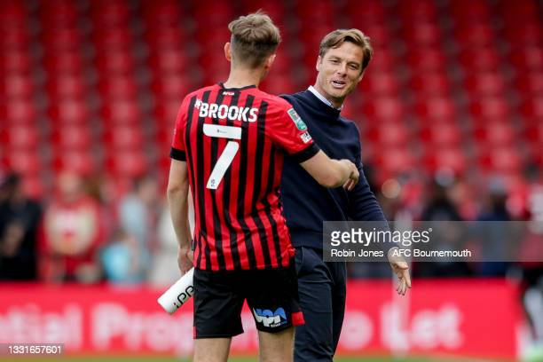 Head Coach Scott Parker of Bournemouth waits for David Brooks who scored two goals in his sides 5-0 win during the Carabao Cup 1st Round match...