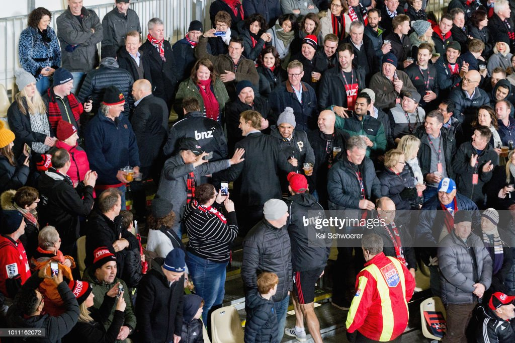 Head Coach Scott Robertson of the Crusaders (C) greets fans on his way to the coaches box prior to the Super Rugby Final match between the Crusaders and the Lions at AMI Stadium on August 4, 2018 in Christchurch, New Zealand.