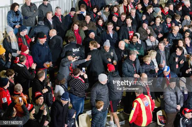 Head Coach Scott Robertson of the Crusaders greets fans on his way to the coaches box prior to the Super Rugby Final match between the Crusaders and...
