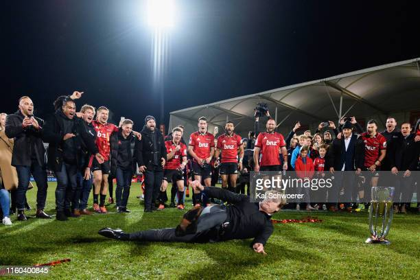 Head Coach Scott Robertson of the Crusaders makes a breakdance around the Super Rugby trophy after the win in the Super Rugby Final between the...