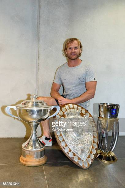 Head Coach Scott Robertson of the Crusaders poses with the Rugby Cup the Ranfurly Shield and the Super Rugby Trophy following a Canterbury Rugby...