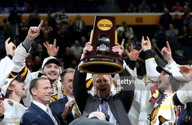 Head coach Scott Sandelin of the Minnesota-Duluth Bulldogs celebrates with the trophy after the 2019 NCAA Frozen Four the championship game at...