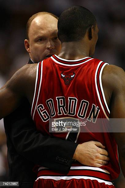 Head Coach Scott Skiles of the Chicago Bulls hugs and chats with Ben Gordon in the fourth period against the Miami Heat in Game Three of the Eastern...