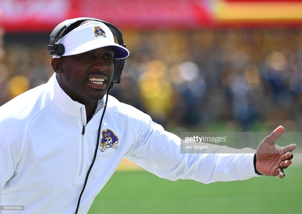 Head coach Scottie Montgomery of the East Carolina Pirates looks on during the first quarter against the West Virginia Mountaineers at Mountaineer Field on September 9, 2017 in Morgantown, West Virginia.
