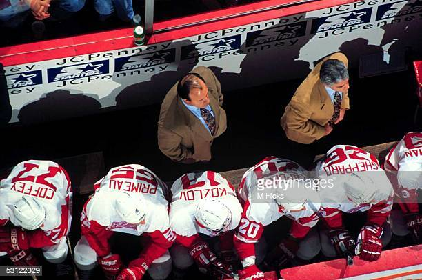 53621c2f45f Head coach Scotty Bowman of the Detroit Red Wings stands behind the bench  during an NHL