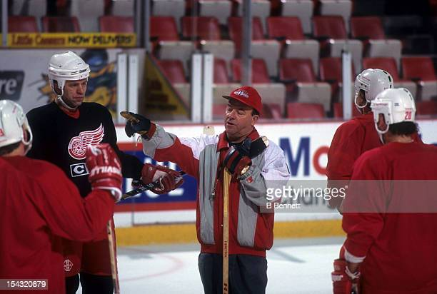 Head coach Scotty Bowman of the Detroit Red Wings talks to his players including Viacheslav Fetisov during practice before a 1995 Stanley Cup game...