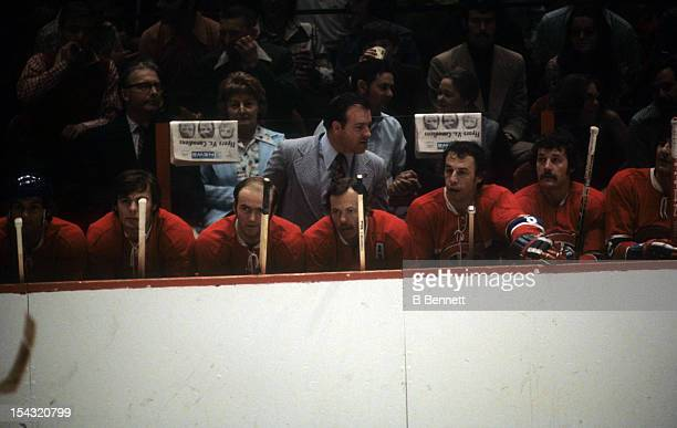 Head coach Scotty Bowman of the Montreal Canadiens looks on from the bench during an NHL game against the Philadelphia Flyers circa 1975 at the...