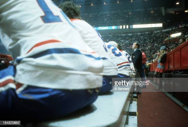 Head coach Scotty Bowman of the Montreal Canadiens looks on from the bench during an NHL game circa 1976 at the Montreal Forum in Montreal Quebec...