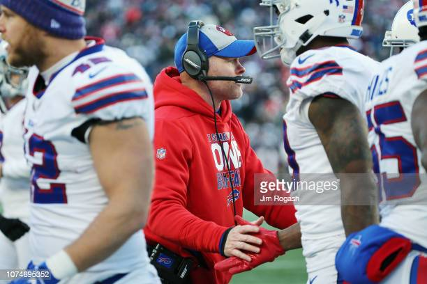 Head coach Sean McDermott of the Buffalo Bills high fives players on the sideline during the second half against the New England Patriots at Gillette...