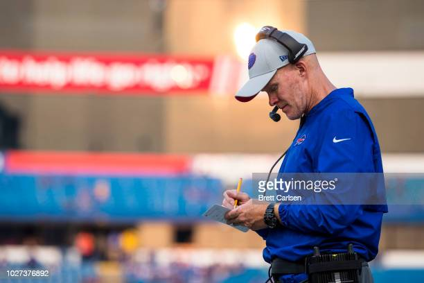 Head coach Sean McDermott of the Buffalo Bills takes notes during the preseason game against the Cincinnati Bengals at New Era Field on August 26...