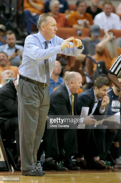 Head coach Sean McDonnell of the New Hampshire Wildcats calls a play against the Texas Longhorns at the Frank Erwin Center on November 14 2017 in...