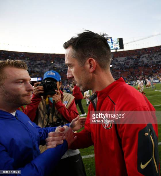 Head Coach Sean McVay of the Los Angeles Rams and Head Coach Kyle Shanahan of the San Francisco 49ers talk on the field following the game at the LA...