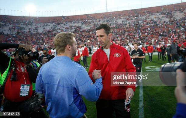 Head Coach Sean McVay of the Los Angeles Rams and Head Coach Kyle Shanahan of the San Francisco 49ers shake hands on the field following the game at...