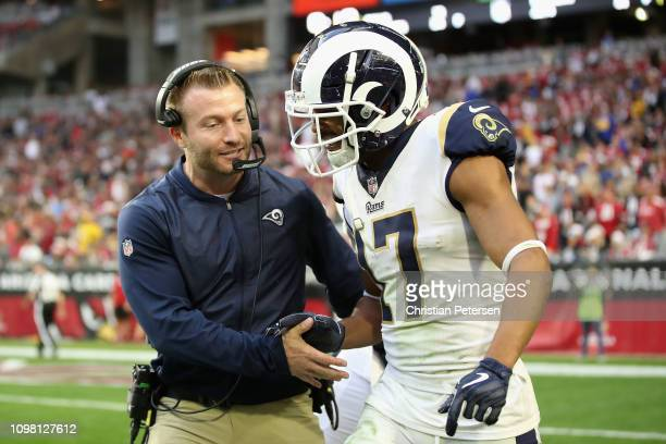 Head coach Sean McVay of the Los Angeles Rams celebrates with wide receiver Robert Woods during the NFL game against the Arizona Cardinals at State...