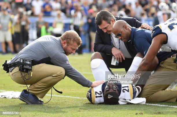 Head coach Sean McVay of the Los Angeles Rams comforts cornerback Kayvon Webster after he ruptured his Achilles tendon during the first half against...