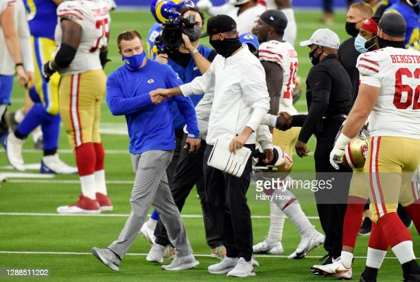 Head coach Sean McVay of the Los Angeles Rams shakes hands with head coach Kyle Shanahan of the San Francisco 49ers after the San Francisco 49ers...