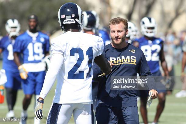 Head Coach Sean McVay of the Los Angeles Rams shakes Kayvon Webster after completing a drill during Training Camp at Crawford Field on July 30 2017...