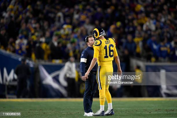 Head coach Sean McVay of the Los Angeles Rams talks to quarterback Jared Goff during the game against the Baltimore Ravens at Los Angeles Memorial...