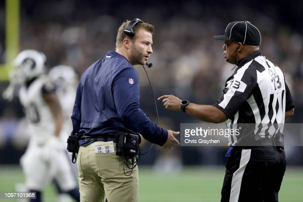 Head coach Sean McVay of the Los Angeles Rams talks with head linesman Patrick Turner during the second quarter in the NFC Championship game against...