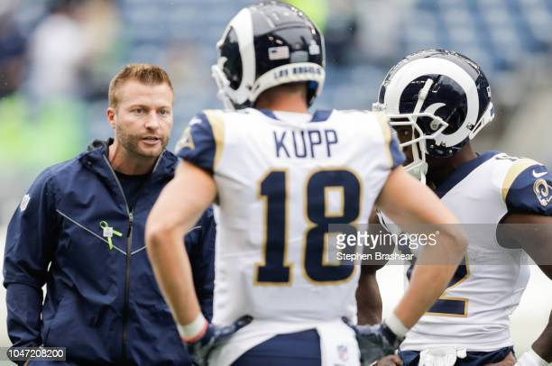 Head Coach Sean McVay of the Los Angeles Rams talks with Wide Receiver Cooper Kupp before the game against the Seattle Seahawks at CenturyLink Field...