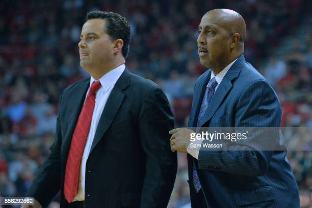 Head coach Sean Miller and associate head coach Lorenzo Romar of the Arizona Wildcats look on during their game against the UNLV Rebels at the Thomas...