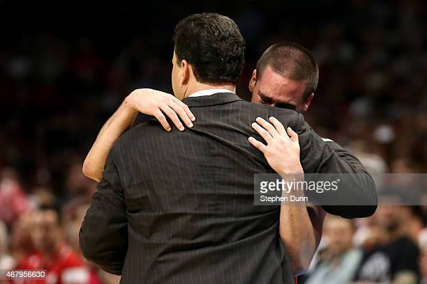 Head coach Sean Miller hugs TJ McConnell of the Arizona Wildcats late in the second half as McConnell is taken out of the game against the Wisconsin...