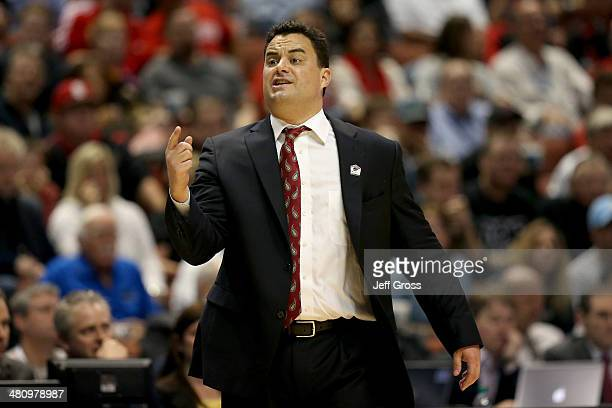 Head coach Sean Miller of the Arizona Wildcats calls out in the first half while taking on the San Diego State Aztecs during the regional semifinal...