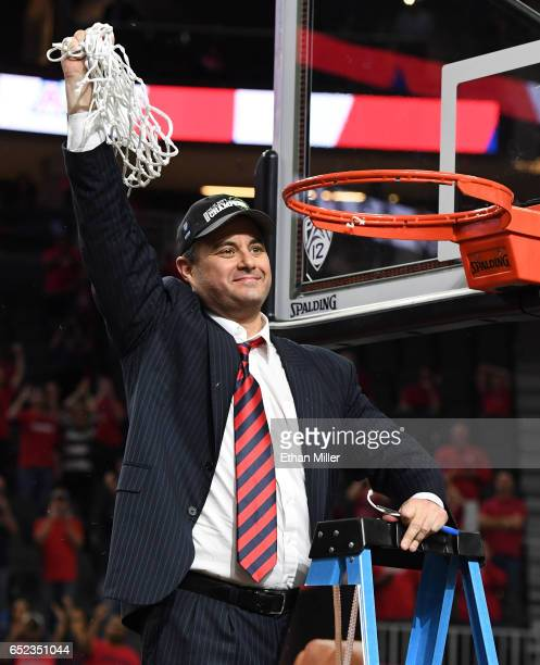 Head coach Sean Miller of the Arizona Wildcats celebrates after cutting down a net following the team's 8380 victory over the Oregon Ducks to win the...
