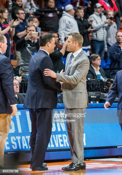 Head Coach Sean Miller of the Arizona Wildcats congratulates Head Coach Nate Oats of the Buffalo Bulls during the NCAA Division I Men's Championship...