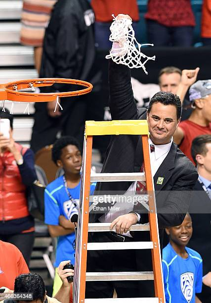 Head coach Sean Miller of the Arizona Wildcats cuts down a net after defeating the Oregon Ducks 8052 to win the championship game of the Pac12...