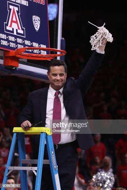 Head coach Sean Miller of the Arizona Wildcats cuts down the nets after defeating the California Golden Bears 66-54 to win the PAC-12 Championship at...