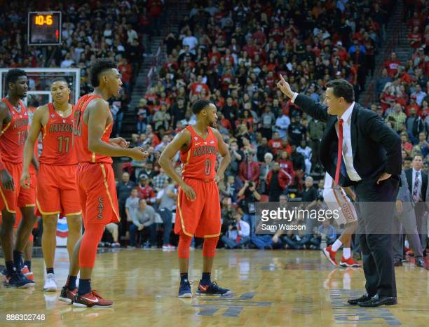 head coach Sean Miller of the Arizona Wildcats gestures to his team during a timeout in their game against the UNLV Rebels at the Thomas Mack Center...