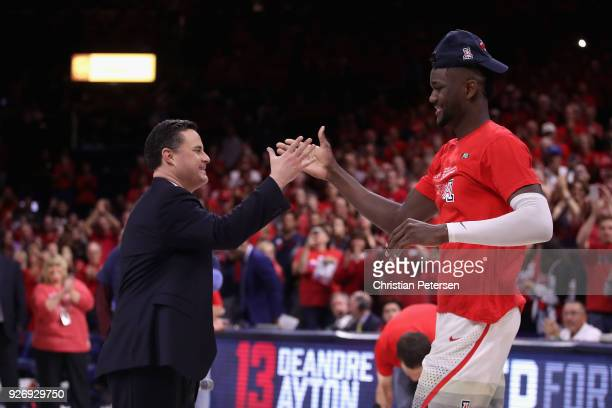 Head coach Sean Miller of the Arizona Wildcats greets Deandre Ayton after defeating the California Golden Bears 66-54 to win the PAC-12 Championship...