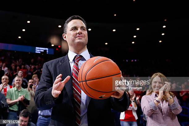 Head coach Sean Miller of the Arizona Wildcats is congratulated after winning his 300th career game following the college basketball game against the...