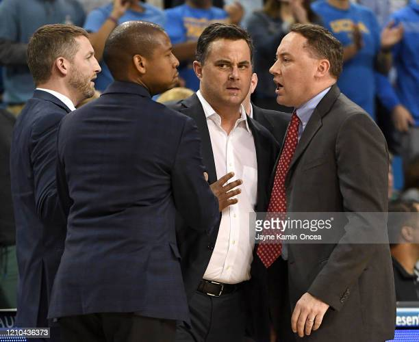 Head coach Sean Miller of the Arizona Wildcats is held back by his coaching staff during an argument with officials during the game against the UCLA...