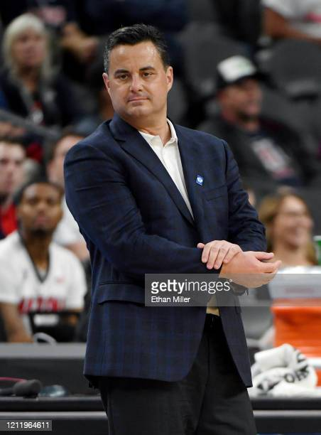 Head coach Sean Miller of the Arizona Wildcats looks on as his players take on the Washington Huskies during the first round of the Pac-12 Conference...