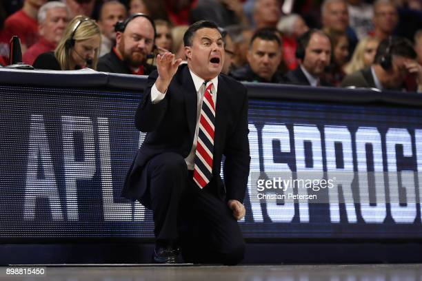 Head coach Sean Miller of the Arizona Wildcats looks on during the first half of the college basketball game against the Connecticut Huskies at...