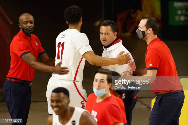 Head coach Sean Miller of the Arizona Wildcats reacts as he walks off the court after defeating the Arizona State Sun Devils in the NCAAB game at...