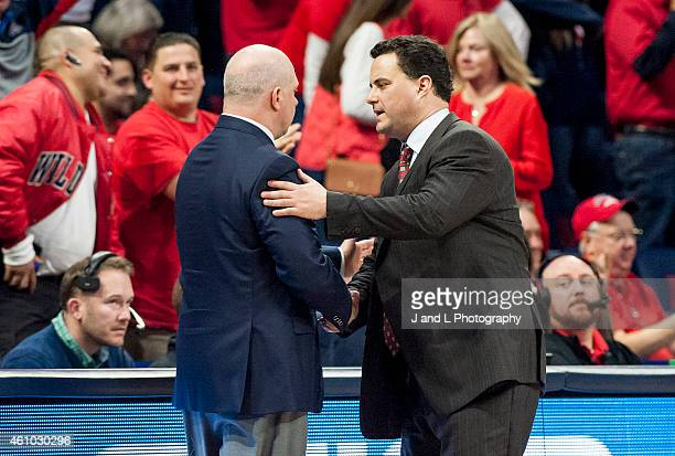 Head coach Sean Miller of the Arizona Wildcats shakes hands with head coach Herb Sendek of the Arizona State Sun Devils after the Wildcats 7349...