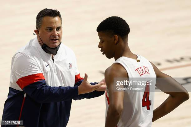 Head coach Sean Miller of the Arizona Wildcats talks with Dalen Terry during the NCAAB game against the UCLA Bruins at McKale Center on January 09,...