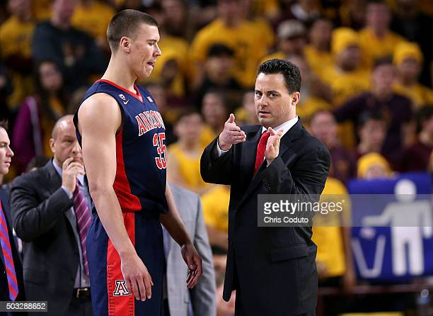 Head coach Sean Miller of the Arizona Wildcats talks with Kaleb Tarczewski during the second half of the college basketball game at Wells Fargo Arena...