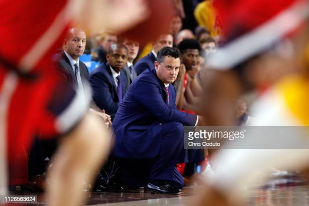Head coach Sean Miller of the Arizona Wildcats watches the action during the first half of the college basketball game against the Arizona State Sun...