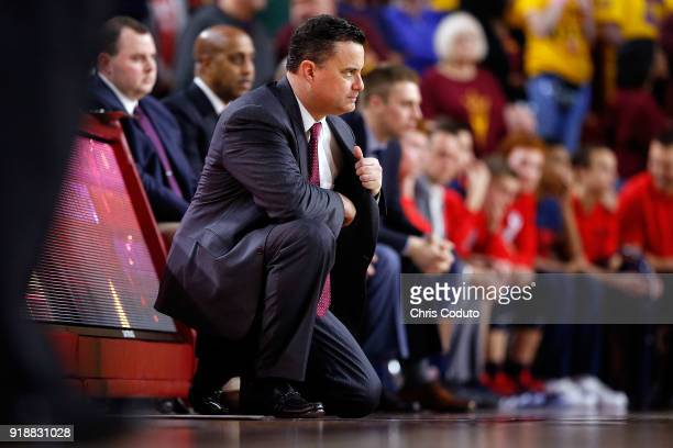 Head coach Sean Miller of the Arizona Wildcats watches the action during the second half of the college basketball game against the Arizona State Sun...